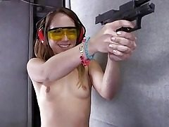 Bare girl Remy LaCroix shooting guns