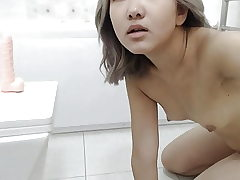 An Chinese Girl Jacks In The Shower