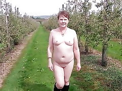 Mouth-watering MILF's Bare Walk Through an Apple Orchard
