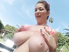 Wild lady is taking off her bikini posing with her giant breasts out