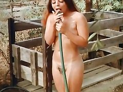 Two cowboys are snooping on this nude babe taking shower outdoors