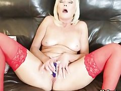 Warm blonde dressed in crimson spandex masturbating her pussy fuckhole all alone