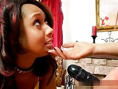 Super-fucking-hot gal dressed in a strap-on fucking her girlfriend's nasty mouth